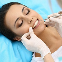 Woman receiving periodontal maintenance treatment