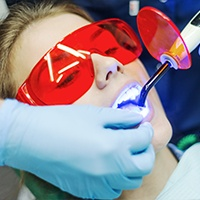 Patient receiving dental sealants