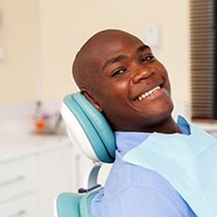 A man smiling at his dental appointment.