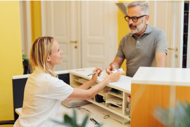 Patient settling root canal payment with receptionist