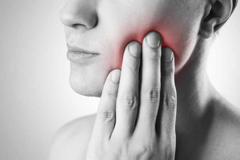 A woman in need of TMJ therapy in Covington.